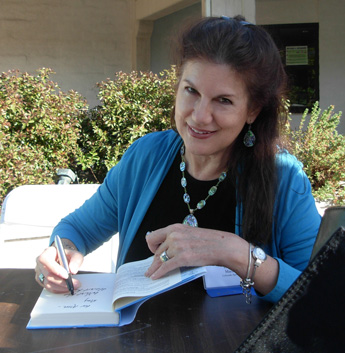 Mara Purl signs at the Central Coast Writer's Conference
