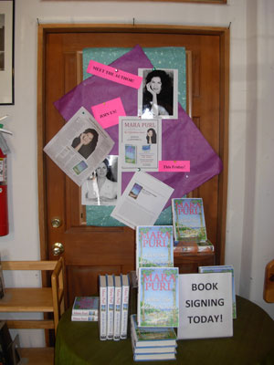Mara Purl signs at Moby Dickens in Taos, NM