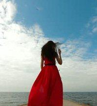 Woman in red dress on pier