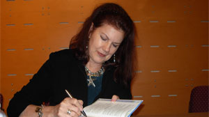 Mara Purl signing at Women's Voices Performance Readings